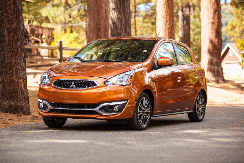 An orange 2019 Mitsubishi Mirage parked in fall, the Mirage is one of the worst used cars and should be skipped for one of the best used cars instead