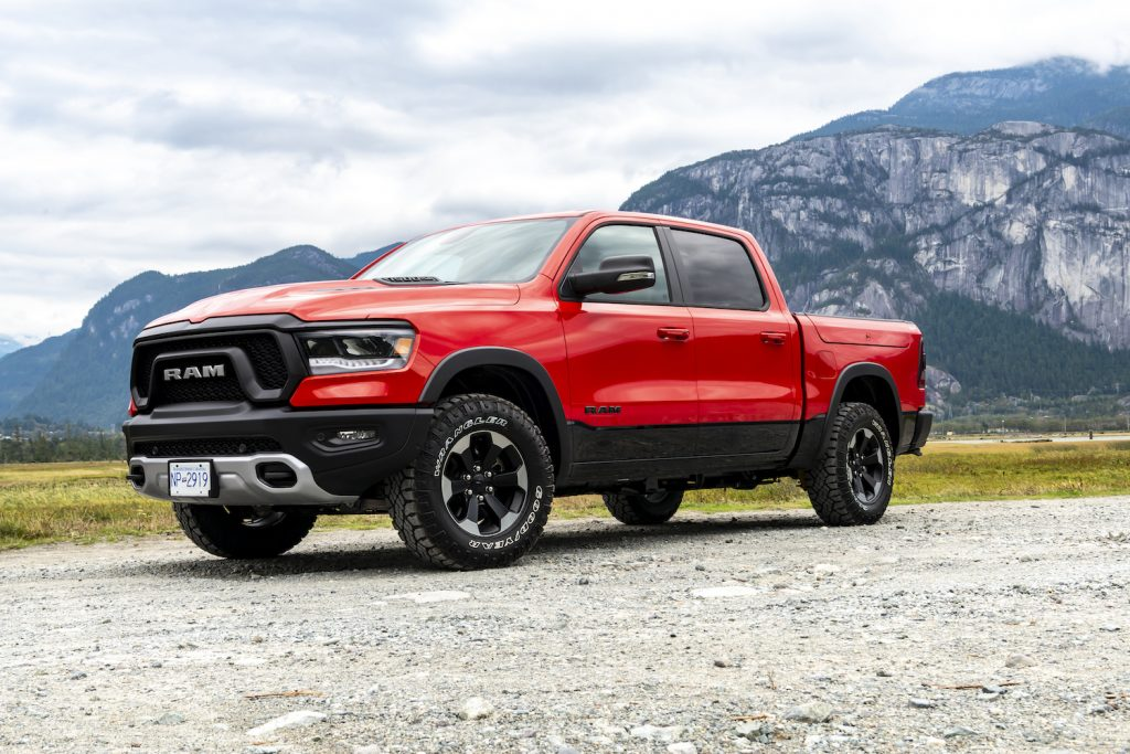 A red 2019 Ram 1500 parked in the mountains