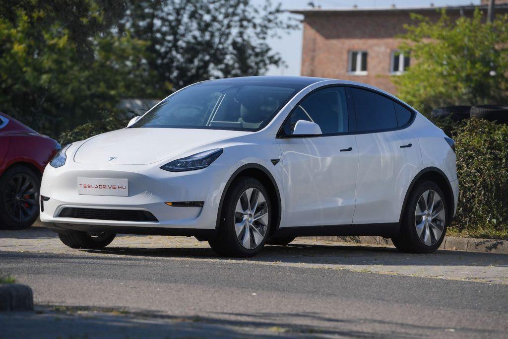 A white 2020 Tesla Model Y parked on concrete
