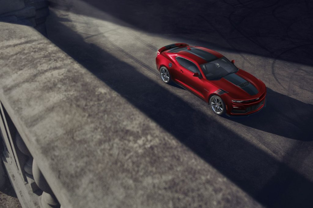 The 2021 Chevrolet Camaro in red surrounded by shadows