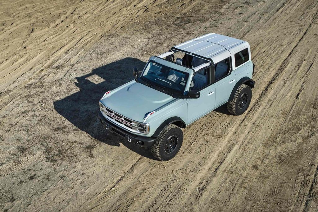 A powder-blue 2021 Ford Bronco SUV is shown from overhead with its roof partially removed