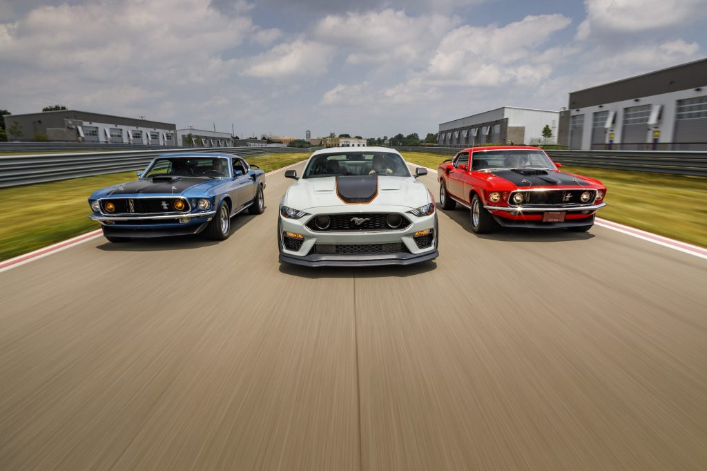After a 17-year hiatus, the 2021 Mustang Mach 1 fastback coupe (center) made its world premiere