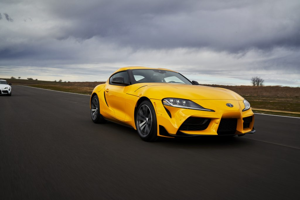 A yellow 2021 Toyota Supra on the track