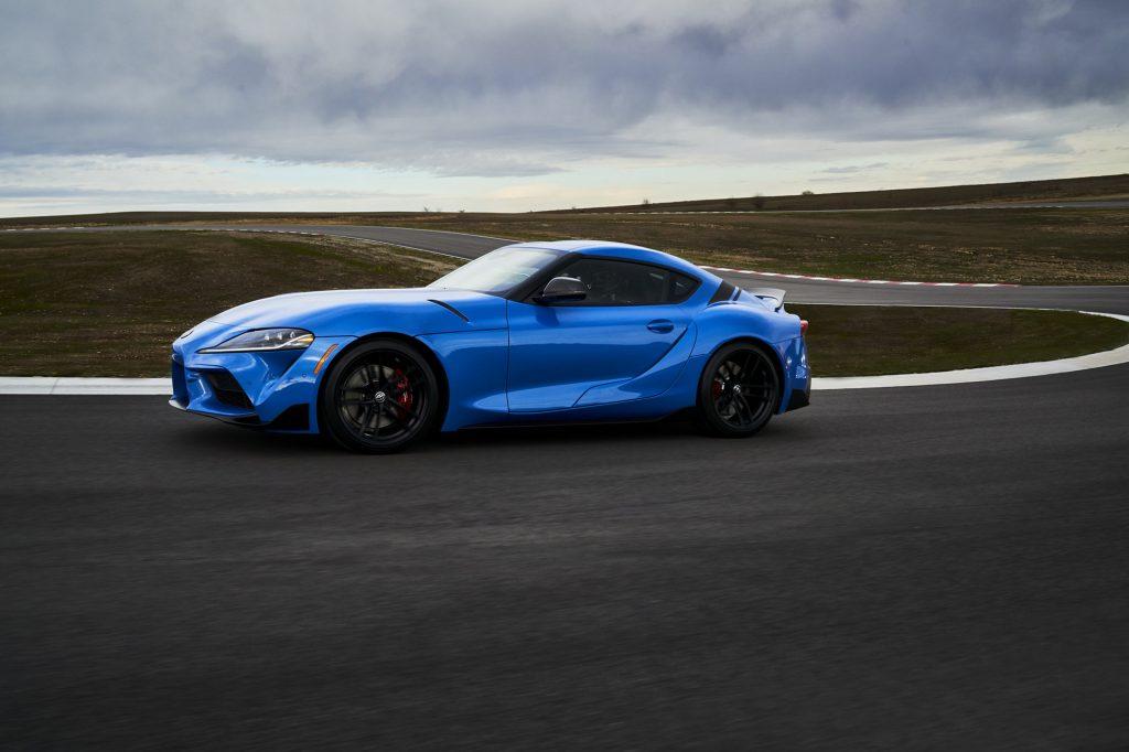 A blue Supra on a race track
