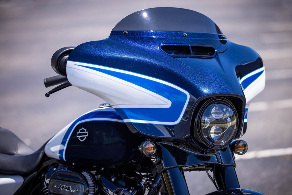 A close-up of the front fairing on a white-blue-and-black 2021 Harley-Davidson Arctic Blast Street Glide Special