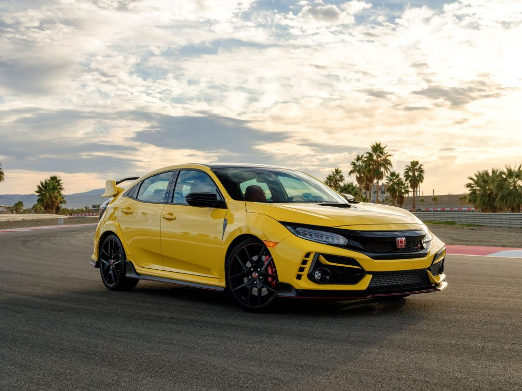 The 2021 Honda Civic Type R Limited Edition model in yellow parked on a racetrack