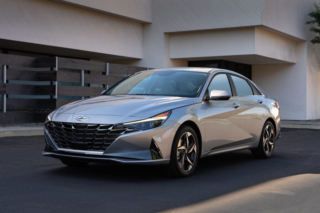 A silver 2021 Hyundai Elantra parked in a driveway, the 2021 Hyundai Elantra is one of the least reliable Hyundai models