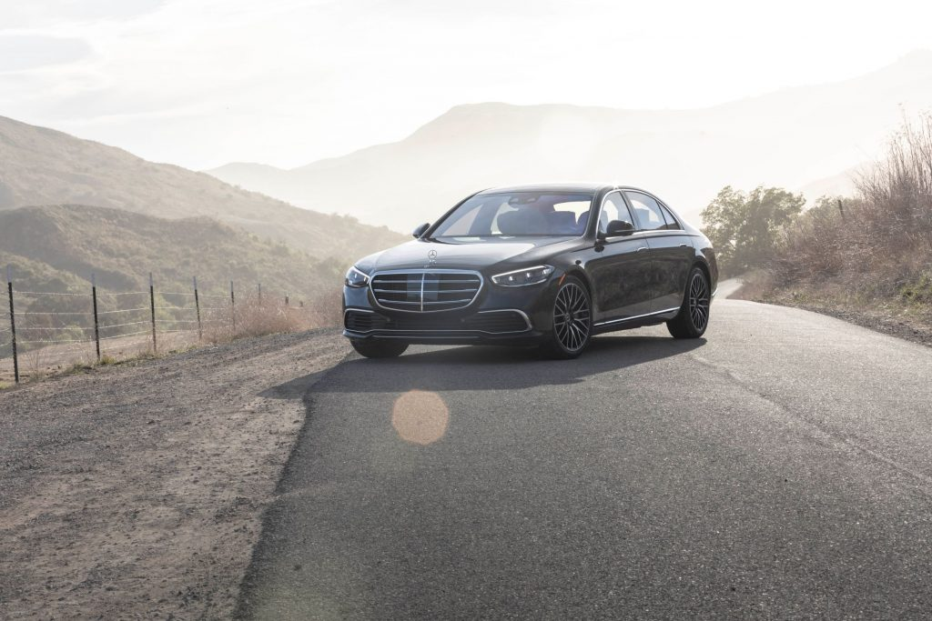 A black 2021 Mercedes-Benz S 580 4Matic S-Class on a mountain road