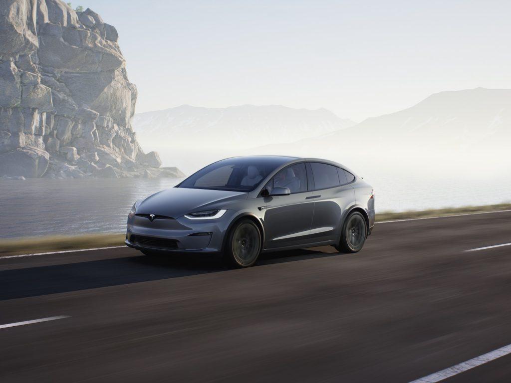 A 2021 Tesla Model X driving through fog