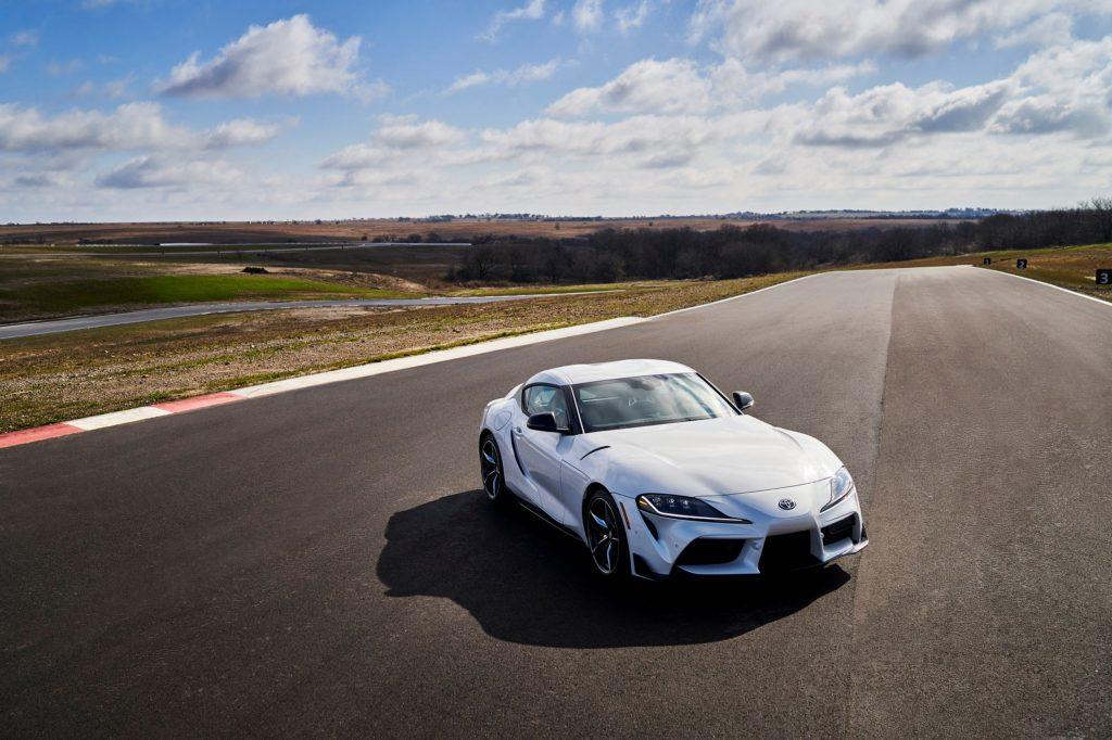A white 2021 Toyota GR Supra 3.0 Premium on a racetrack