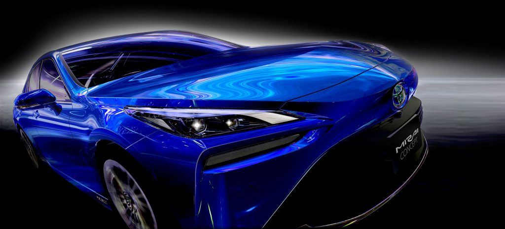 A blue 2021 Toyota Mirai in front of black background with a white glow around the car.
