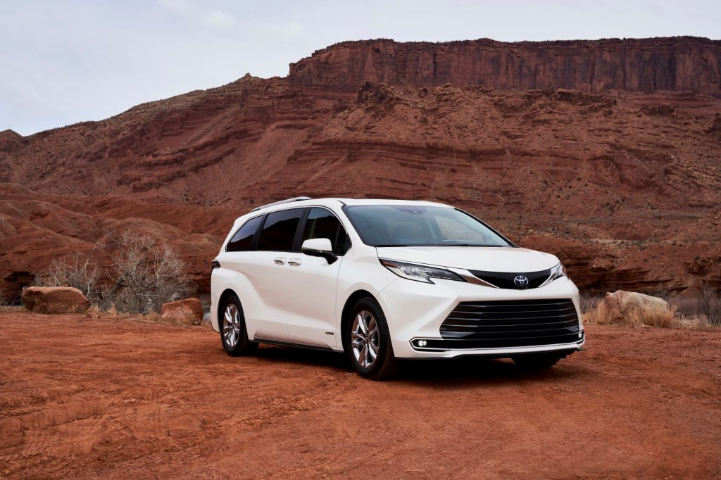 A white 2021 Toyota Sienna in a desert area.