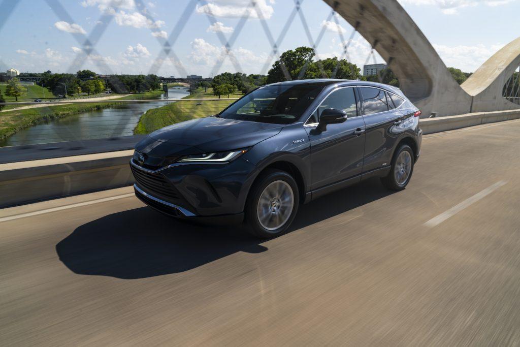 A dark grey 2021 Toyota Venza driving over a bridge