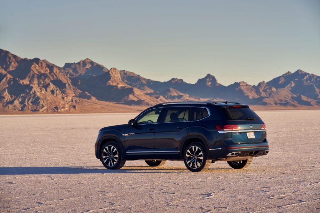 A dark blue 2021 Volkswagen Atlas SUV model parked in the middle of a desert plain