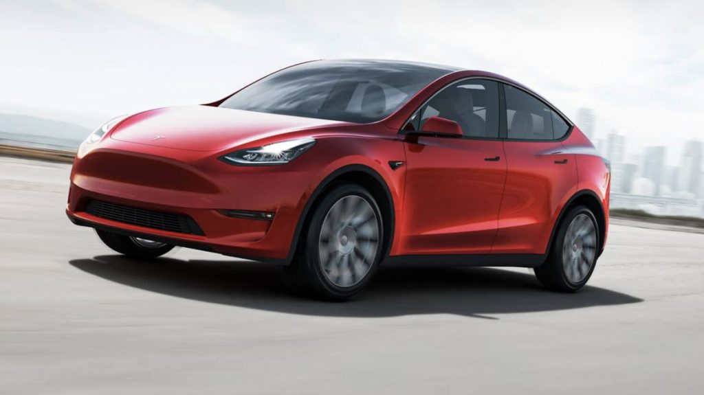 A red 2021 Tesla Model Y on the road