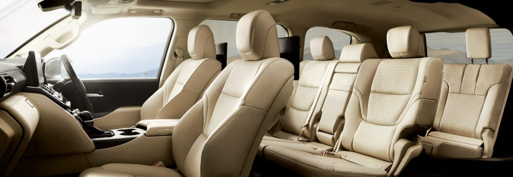 The 2022 Toyota Land Cruiser 300 Series luxury interior with rear entertainment in a creamy tan leather finish