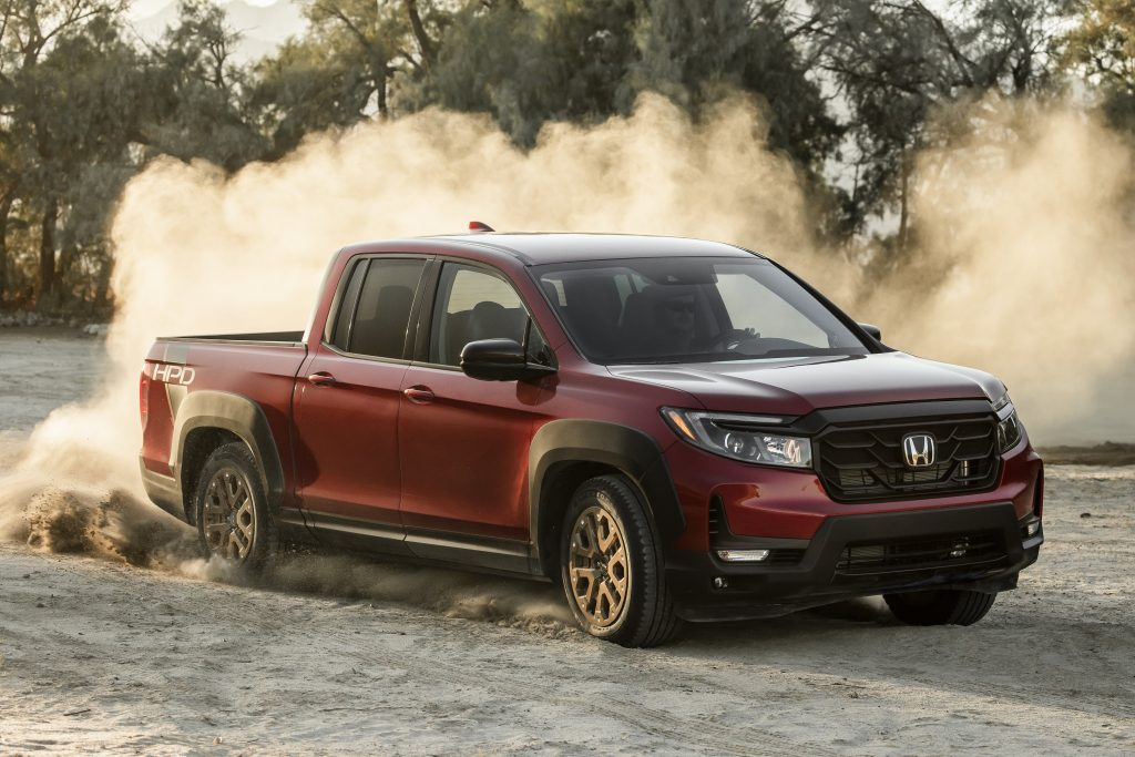 A burgundy 2021 Ridgeline Sport with HPD Package.