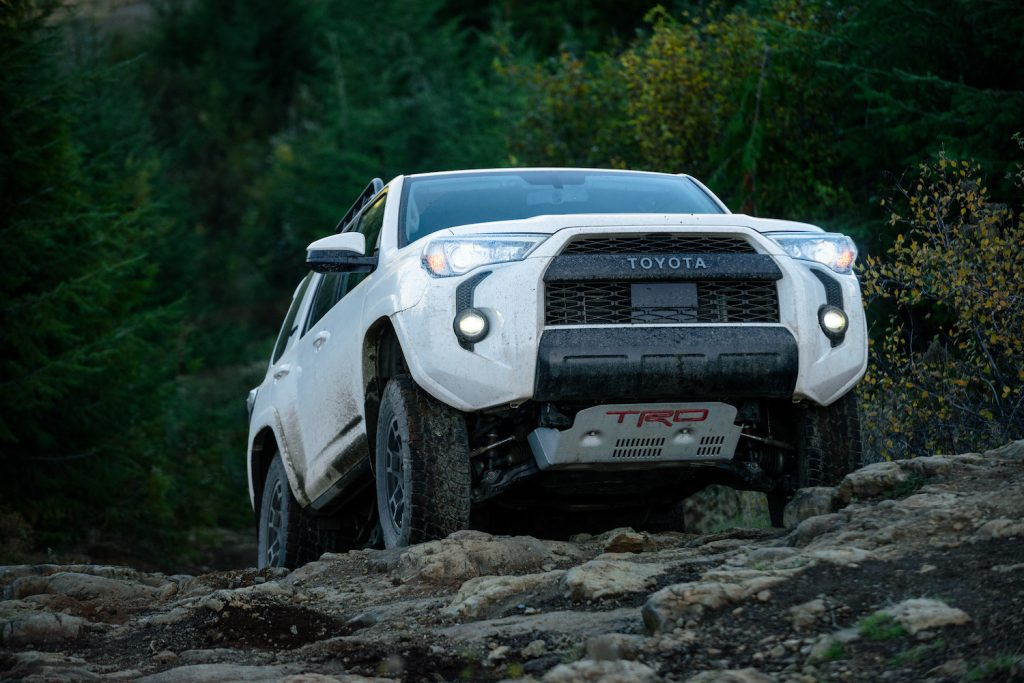 A white 2021 Toyota 4Runner TRD Pro climbing rocks