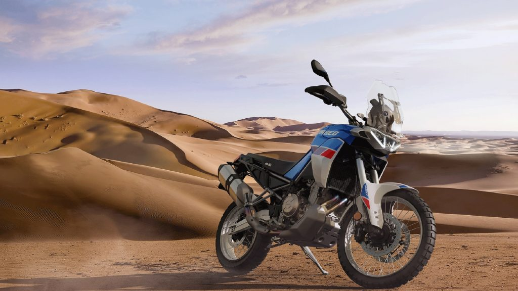 A white-blue-and-red 2022 Aprilia Tuareg 660 in the desert