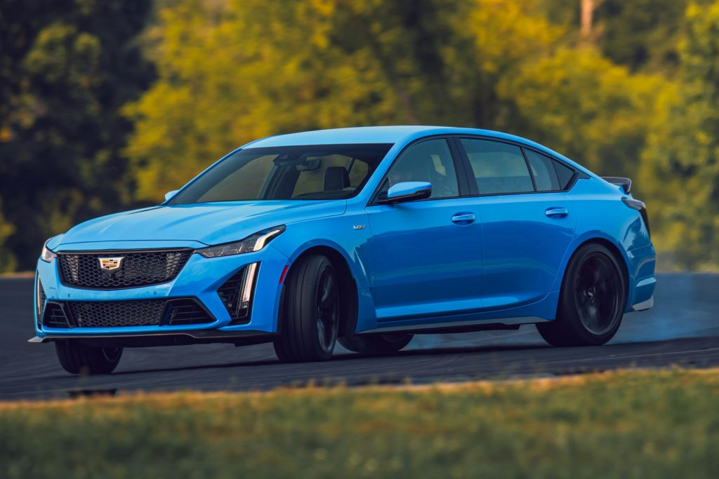 A blue 2022 Cadillac CT5-V Blackwing slides around a racetrack