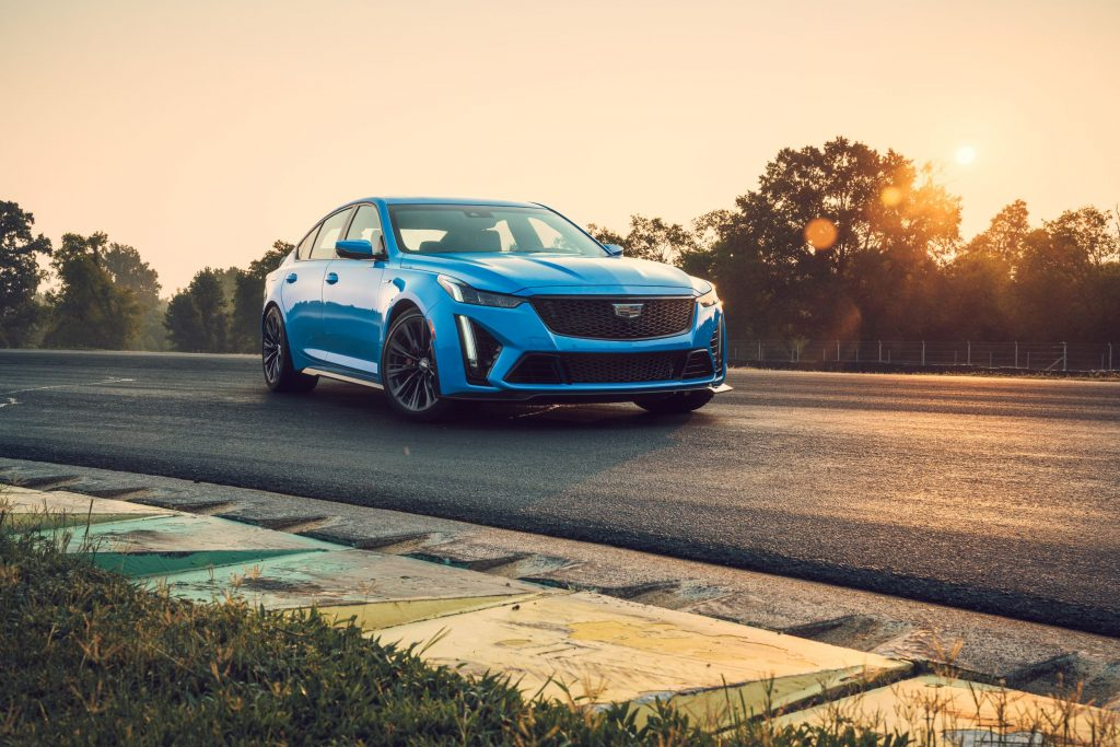 A blue 2022 Cadillac CT5-V Blackwing parked on a racetrack corner