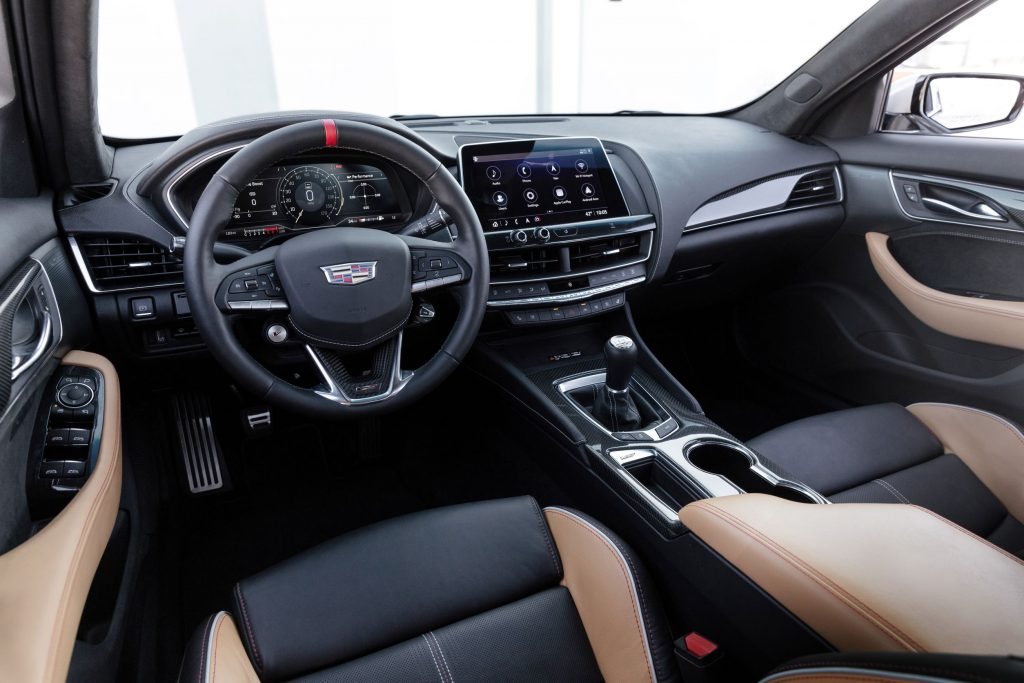 The black-and-tan-upholstered front seats and dashboard of a 2022 Cadillac CT5-V Blackwing with a manual