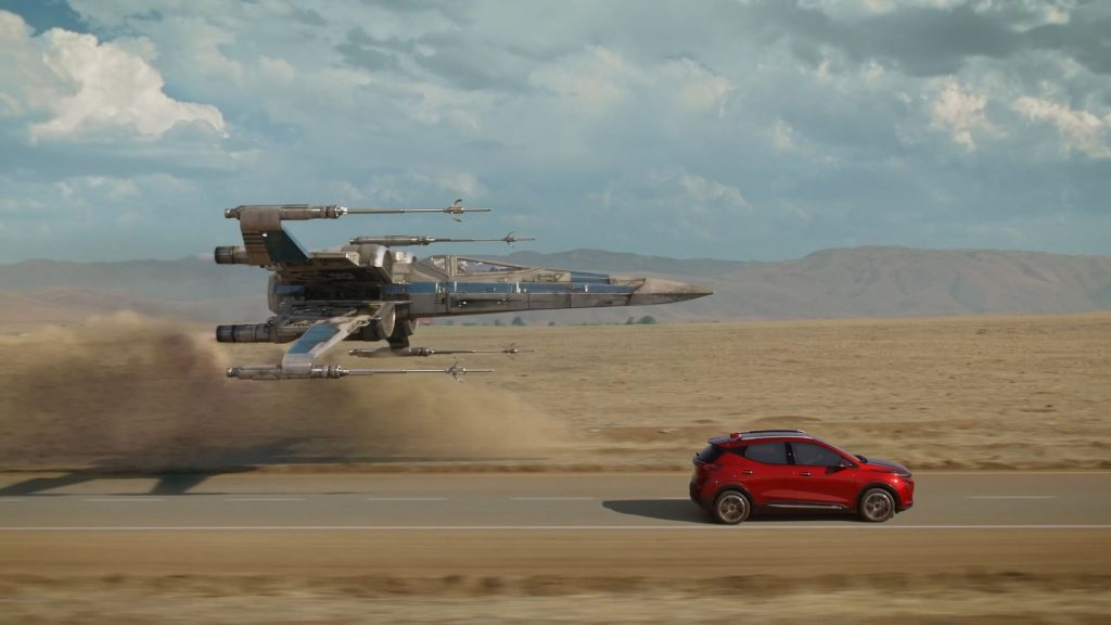 The Chevy Bolt EUV racing a Star Wars X-Wing Fighter in the 'Magic is Electric' Disney commercial