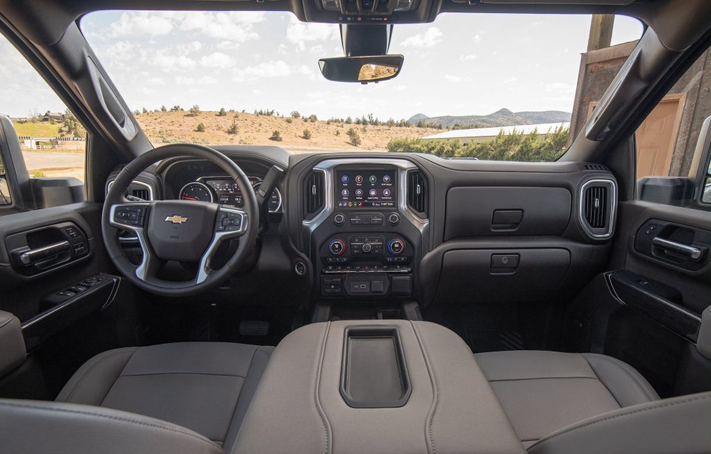 The taupe and black front seats and dashboard of a 2022 Chevrolet Silverado 2500 HD