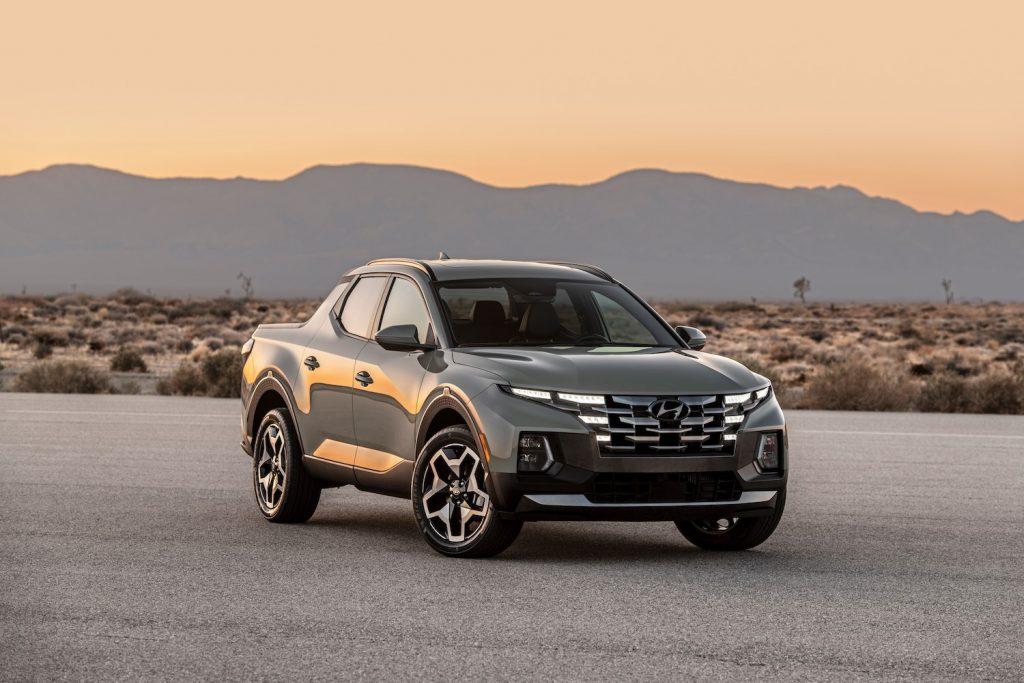 A grey 2022 Hyundai Santa Cruz parked at dusk