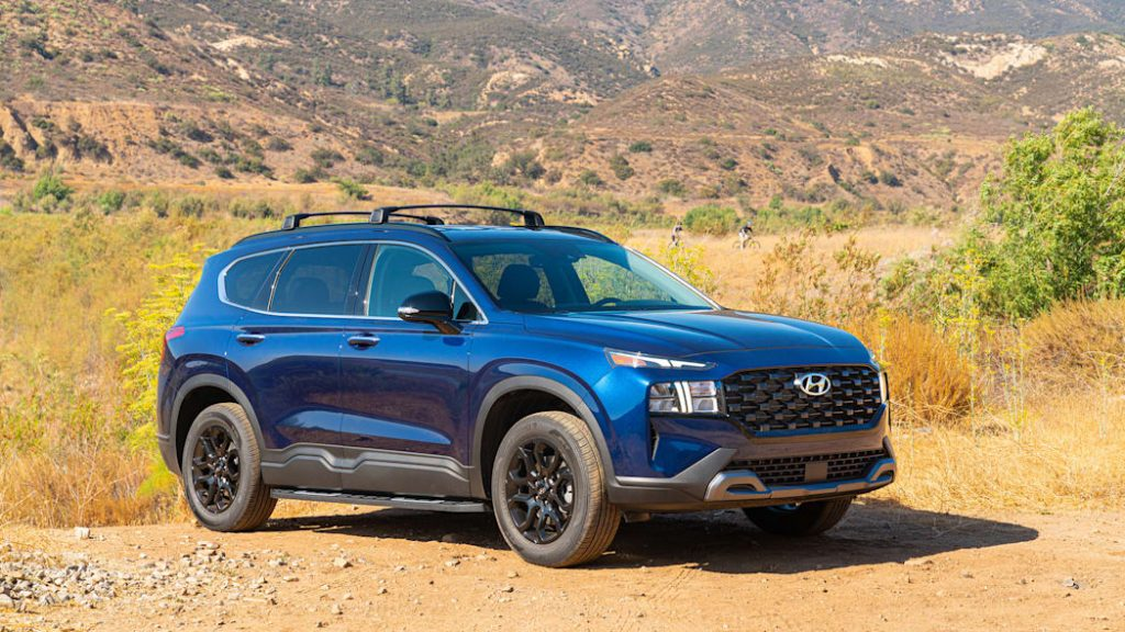 A blue 2022 Hyundai Santa Fe XRT off-roading in dirt