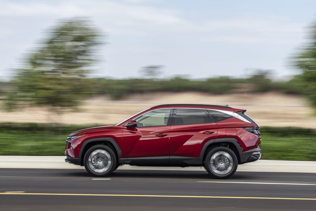A red 2022 Hyundai Tucson driving