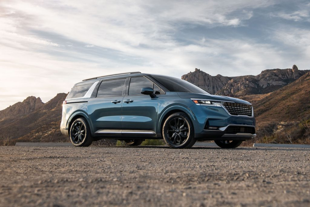 A 2022 Kia Carnival parked in the wilderness