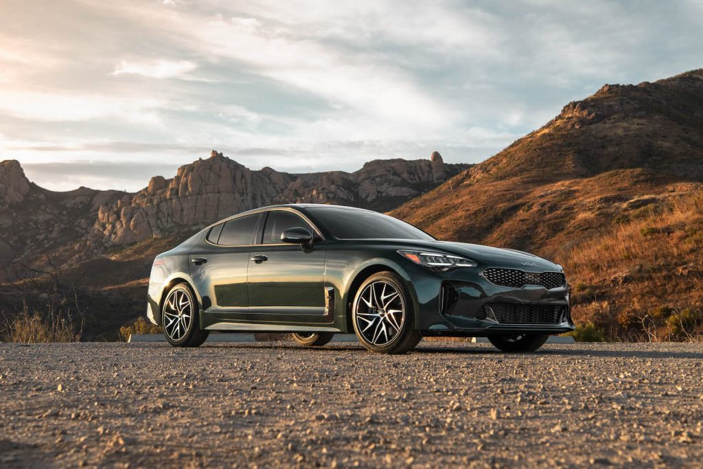 A 2022 Kia Stinger parked in the wilderness, the 2022 Kia Stinger is one of the least reliable new kia models