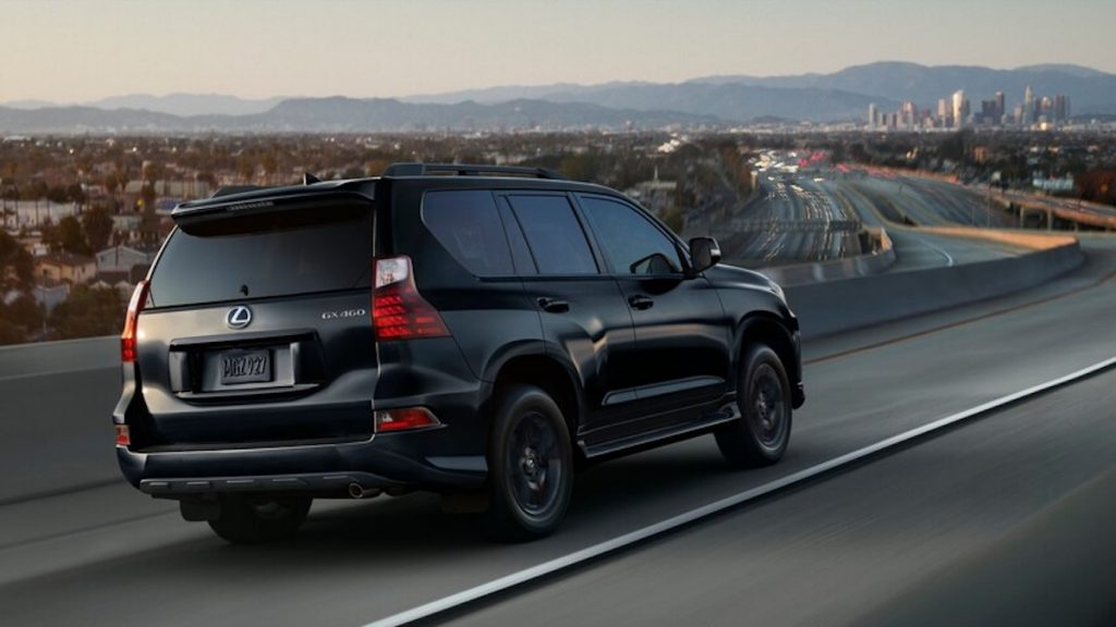 2022 Lexus GX in black driving down the road