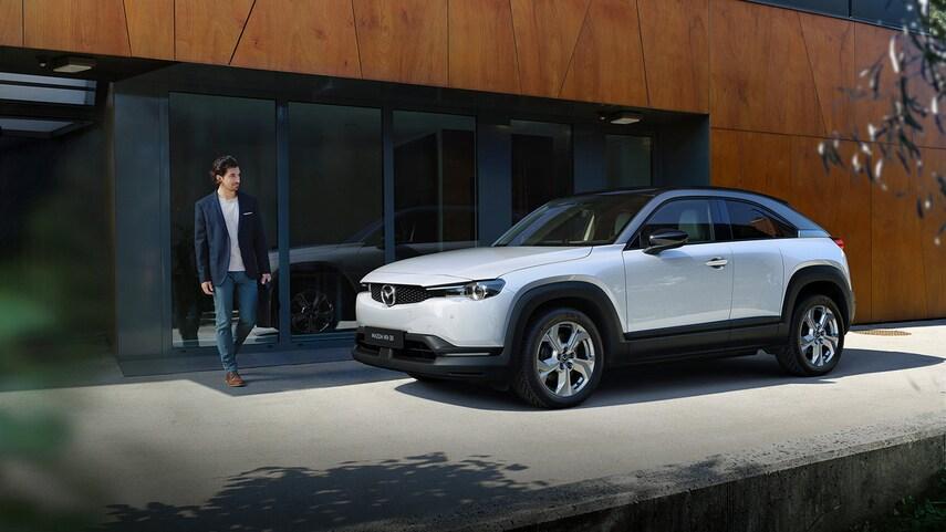 The 2022 Mazda MX-30 EV parked in the city