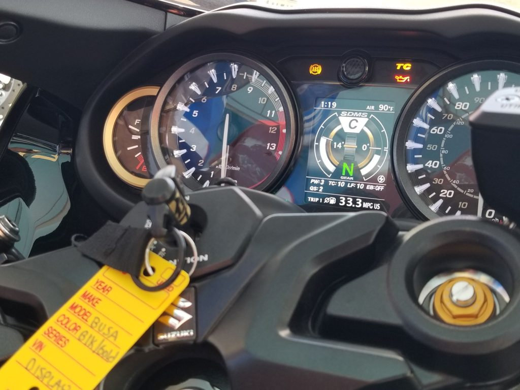 A close-up look at the turned-on TFT display on a 2022 Suzuki Hayabusa