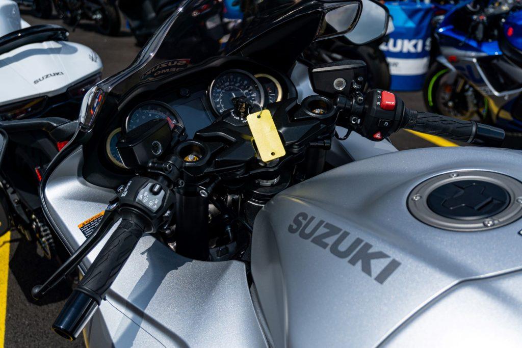 A close-up view of a silver 2022 Suzuki Hayabusa's handlebars and display