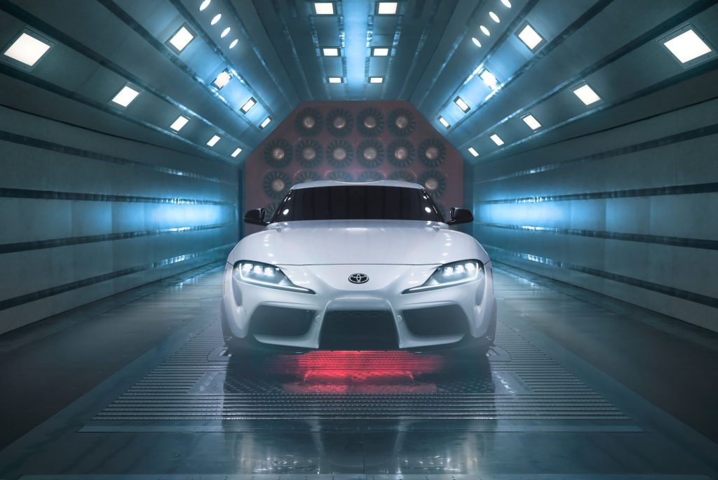 A silver 2022 Toyota Supra in a wind tunnel with lights.