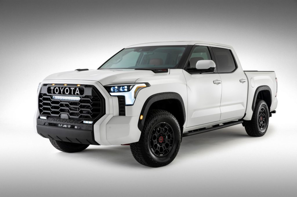 A white 2022 Toyota Tundra on a white background with a black vignette.