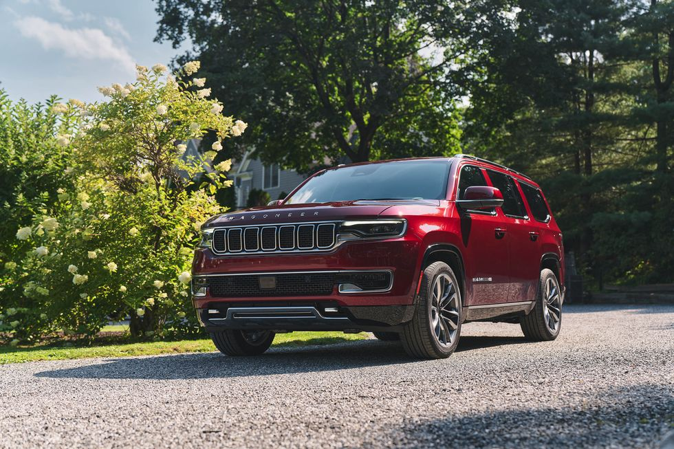 The 2022 Jeep Grand Wagoneer driving down the road.