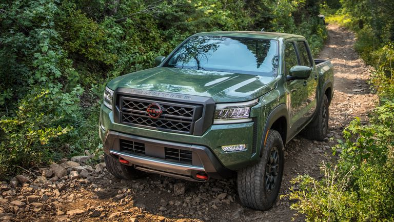 The 2022 Nissan Frontier Pro-4X off-roading in the woods