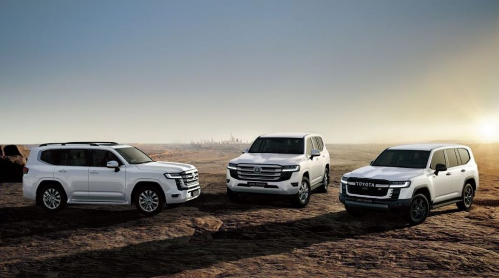 a trio of 2022 Toyota Land Cruisers parked in a desert field