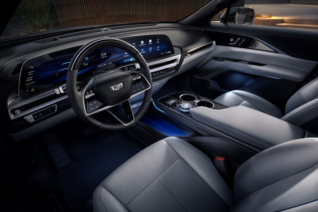 The gray front seats and black dashboard of a 2023 Cadillac Lyriq