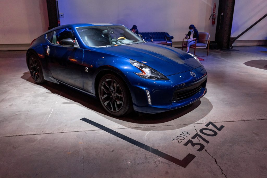 A blue Nissan 370 Z at the debut of Nissan's new Z car