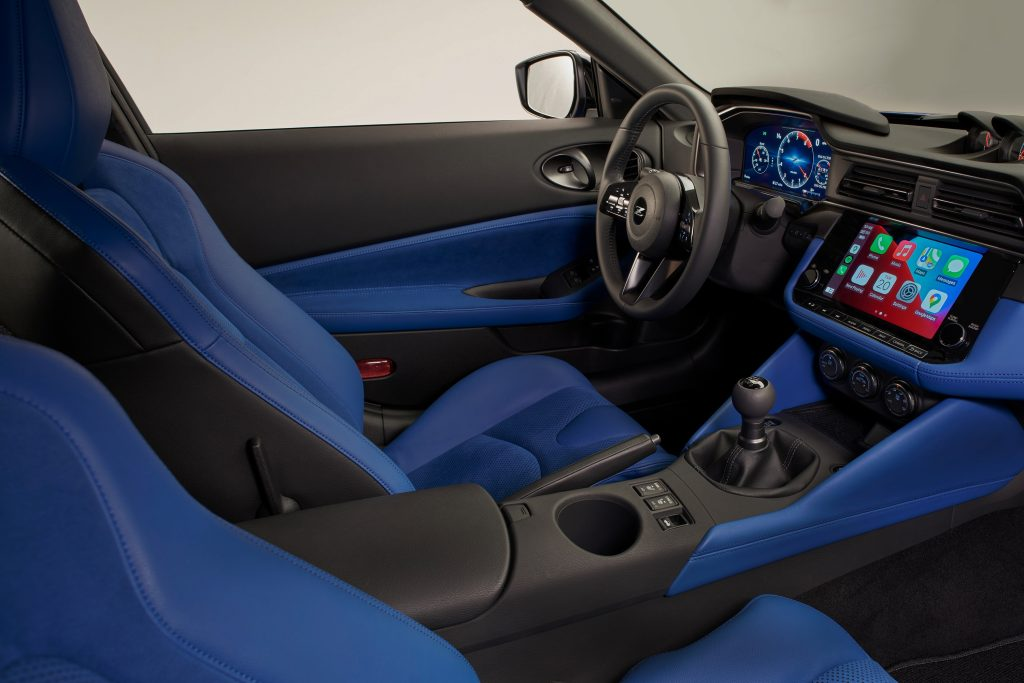 The interior of Nissan's new Z, complete with Carplay and stick shift