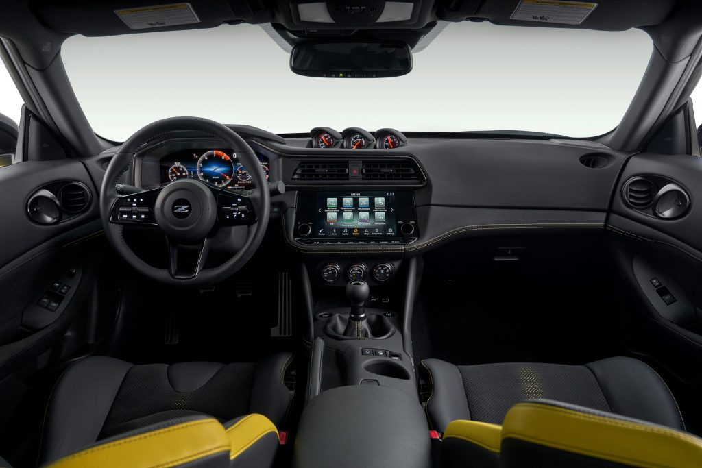 The yellow-accented interior of the new Z coupe, with manual transmission