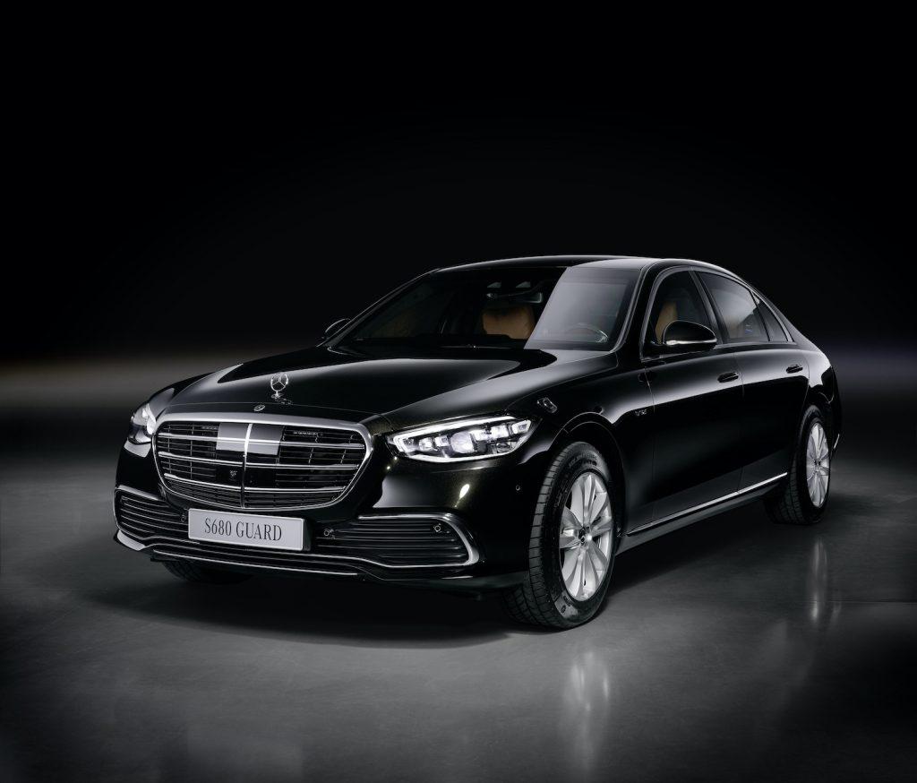 Press photo of a black Mercedes-Benz S 680 GUARD 4MATIC, with the caption: (Kraftstoffverbrauch kombiniert (WLTP): 19,5 l/100 km, CO2-Emissionen kombiniert (WLTP): 442 g/km); Exterieur: onyxschwarz metallic; Interieur: Leder Exclusiv sienabraun/schwarz;Kraftstoffverbrauch kombiniert (WLTP): 19,5 l/100 km, CO2-Emissionen kombiniert (WLTP): 442 g/km* Mercedes-Benz S 680 GUARD 4MATIC (combined fuel consumption (WLTP): 19.5 l/100 km, combined CO2 emissions (WLTP): 442 g/km); exterior: onyx black metallic; interior: Leather exclusive siena brown/black;Combined fuel consumption (WLTP): 19.5 l/100 km, combined CO2 emissions (WLTP): 442 g/km*, one of Car and Driver's most beautiful sedans of 2021