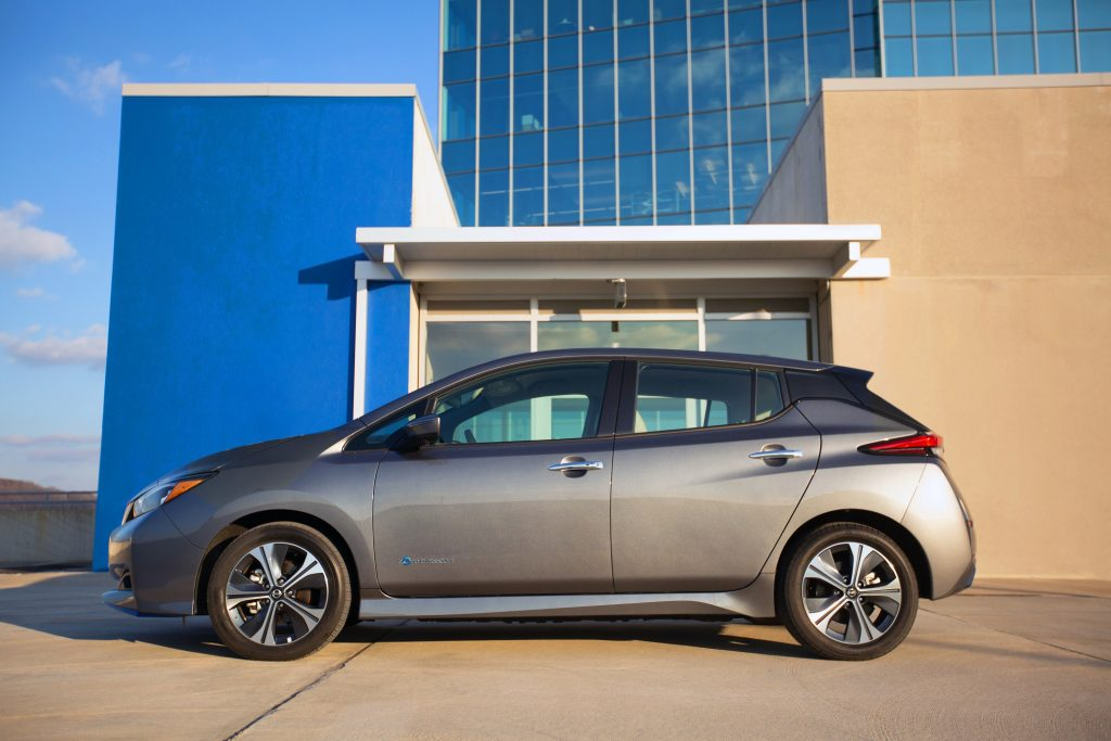 The Nissan Leaf EV, in silver, photographed in profile