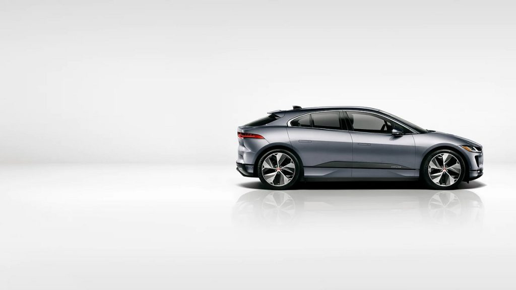 A silver 2021 Jaguar I-Pace against a white background.