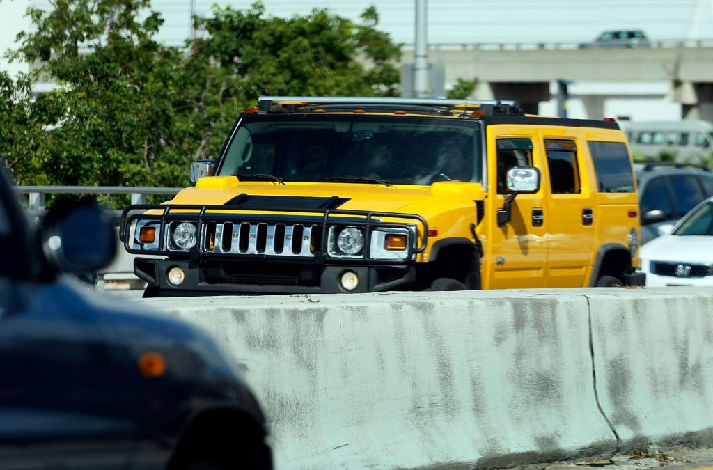 The AM General Hummer in yellow driving in Miami, Florida